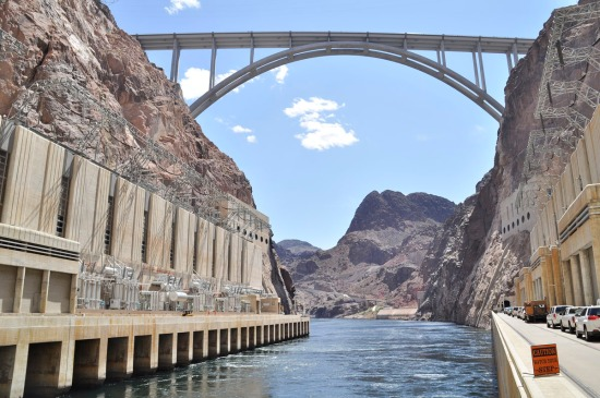 From the base of the dam, the power plants and the Mike O'Callaghan – Pat Tillman Memorial Bridge which allows traffic on U.S. 93 to cross directly into Arizona without having to drive over the dam.
