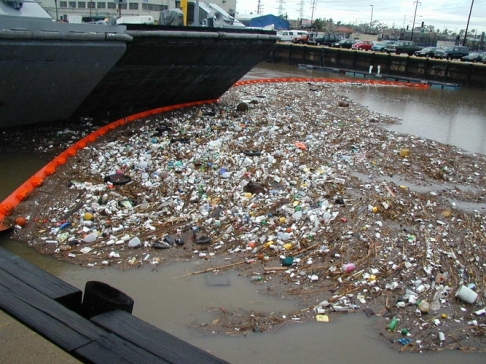 "This photo from the Port of San Diego website shows the ""first flush"" from Chollas Creek into San Diego Bay during a storm. They write: ""All of the big visible trash is the tip of the iceberg -- what you're not seeing are all of the microscopic pollutants such as bacteria, grease, oil, metals, pesticides and fertilizers."""