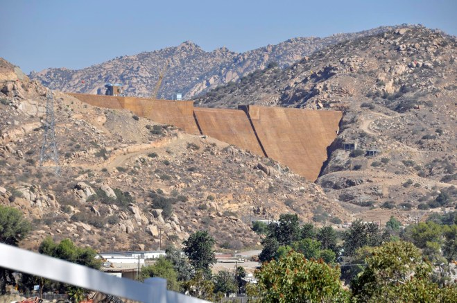The white concrete face of the raised dam at San Vicente Reservoir was recently color coated to reduce the contrast with the surroundings. Note the position of the concrete bunker near the dam's midsection on the hill on the right, then click here to see the dam at its original height.