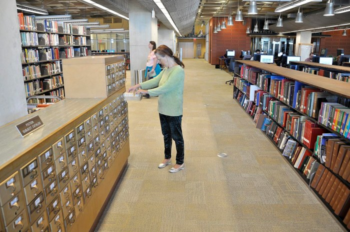 Some bibliographic records have not yet been converted to digital, so card catalogs still live.