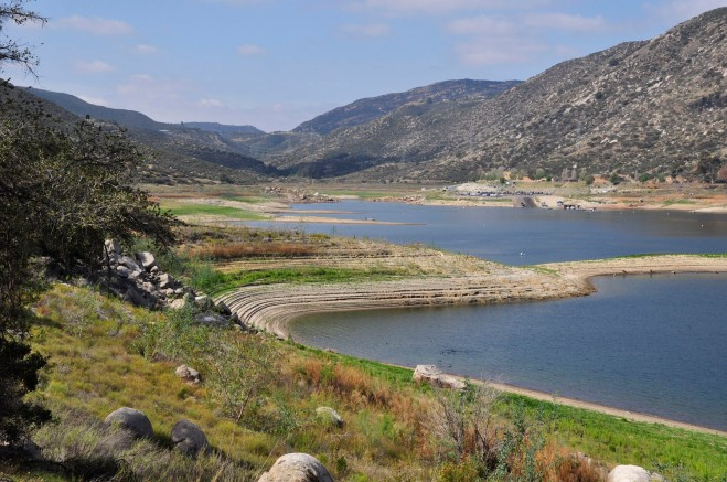 The southern end of El Capitan Reservoir as seen from the old flume grade on the east bank. The 112,806 acre-feet capacity reservoir has a limited ability to receive imported water, has a large watershed, and is primarily used to capture local water.  This mode of operation optimizes local water capture and minimizes spill potential, according to Arian Collins, Public Information Officer for the Public Utilities Dept. The reservoir is now 36% full.